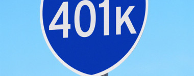 Road Sign Saying To Retirement 401k Invest Wisely --- Image by © Royalty-Free/Corbis